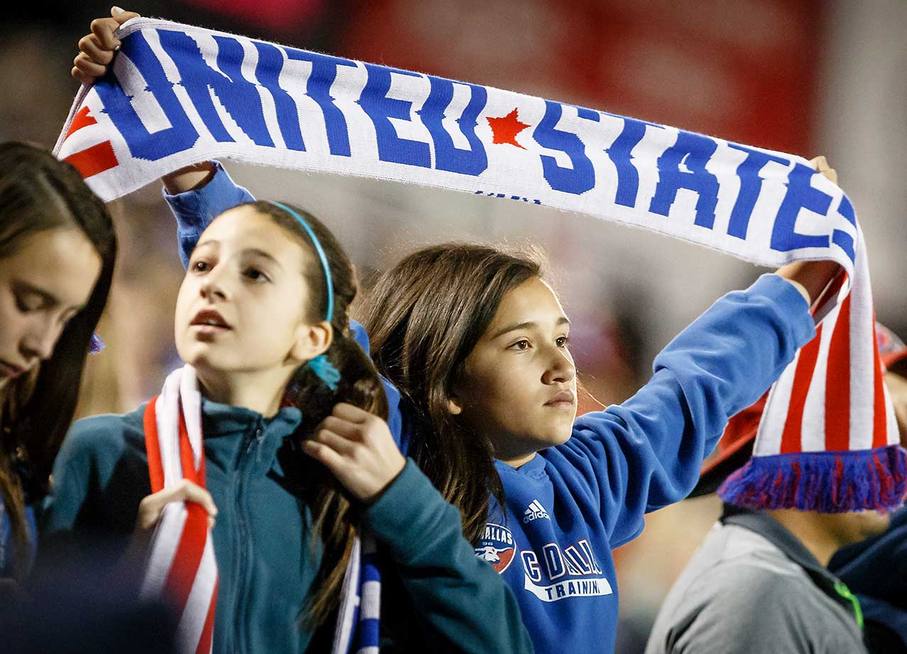 Young fans support the United States during the Olympic qualifying soccer game against Costa Rica.