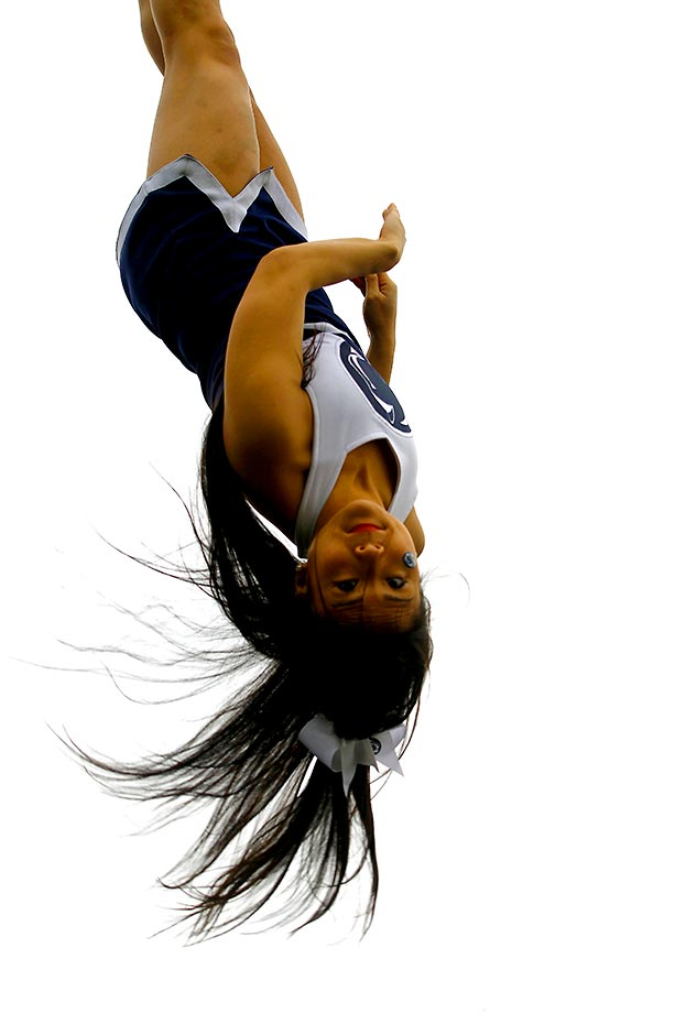 A Penn State cheerleader flips during the Tax Slayer Gator Bowl.
