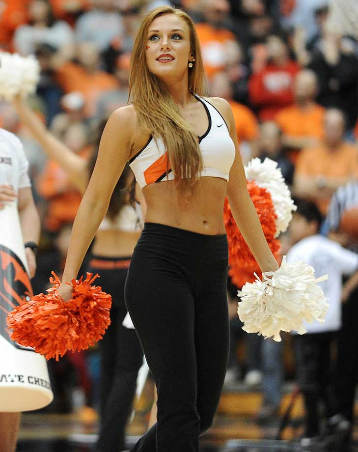 An Oregon State dance team member performs during a timeout between Washington and Oregon State.