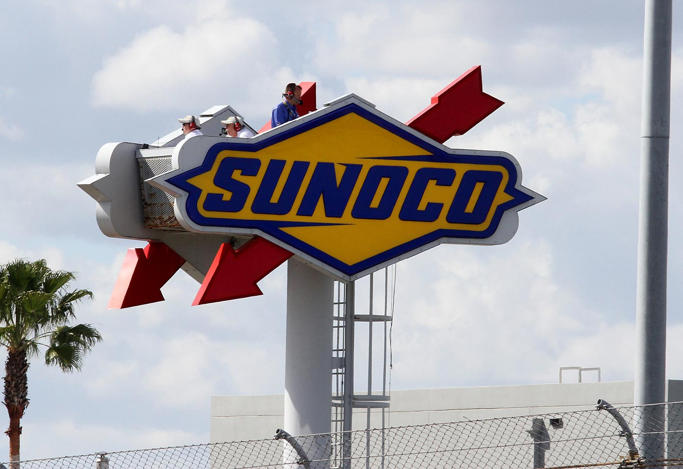 NASCAR officials and the MRN announcers atop the Sunoco sign during the NASCAR Sprint Cup Series Daytona 500 race.