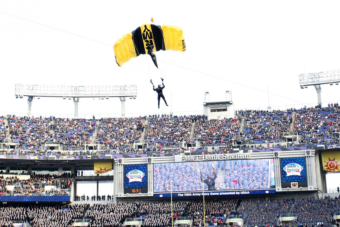 An Army parachute team member enters M&T Bank Stadium prior to the start of the 115th Army-Navy football game.