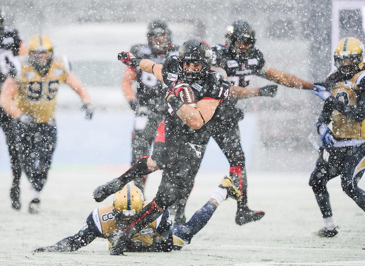 Calgary Stampeders running back Matt Walter plows through the snow against the Winnipeg Blue Bombers. Walter ran for 109 yards in an 18-13 loss.