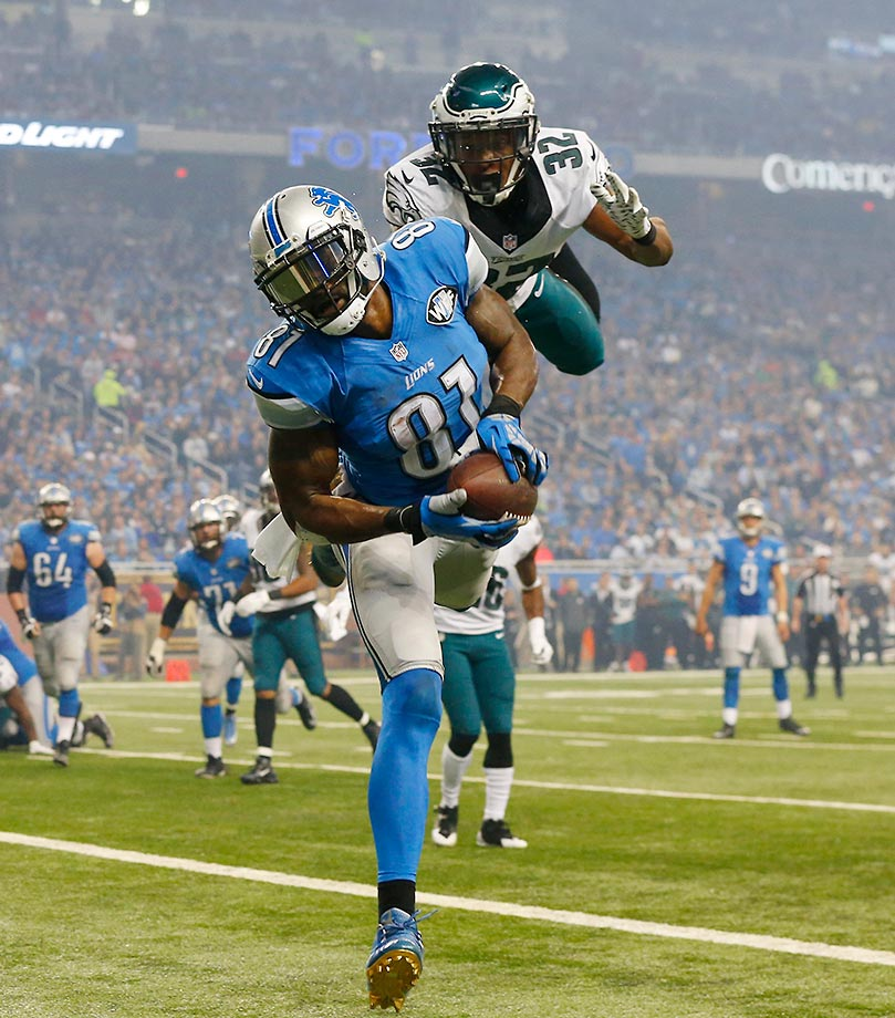 Calvin Johnson of the Detroit Lions scores a touchdown against Eric Rowe of the Eagles.