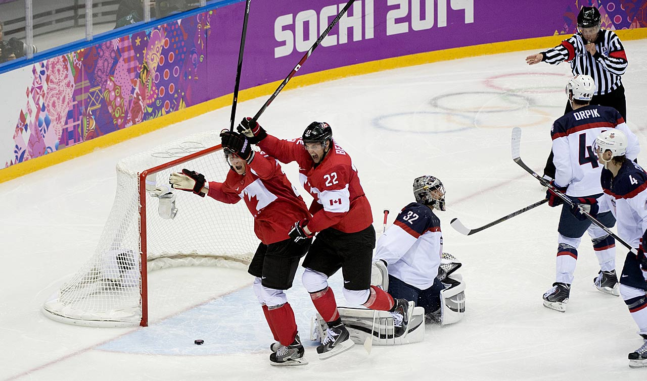 Jamie Benn and Corey Perry react to the first and only score of the semifinal game between the U.S. and Canada.