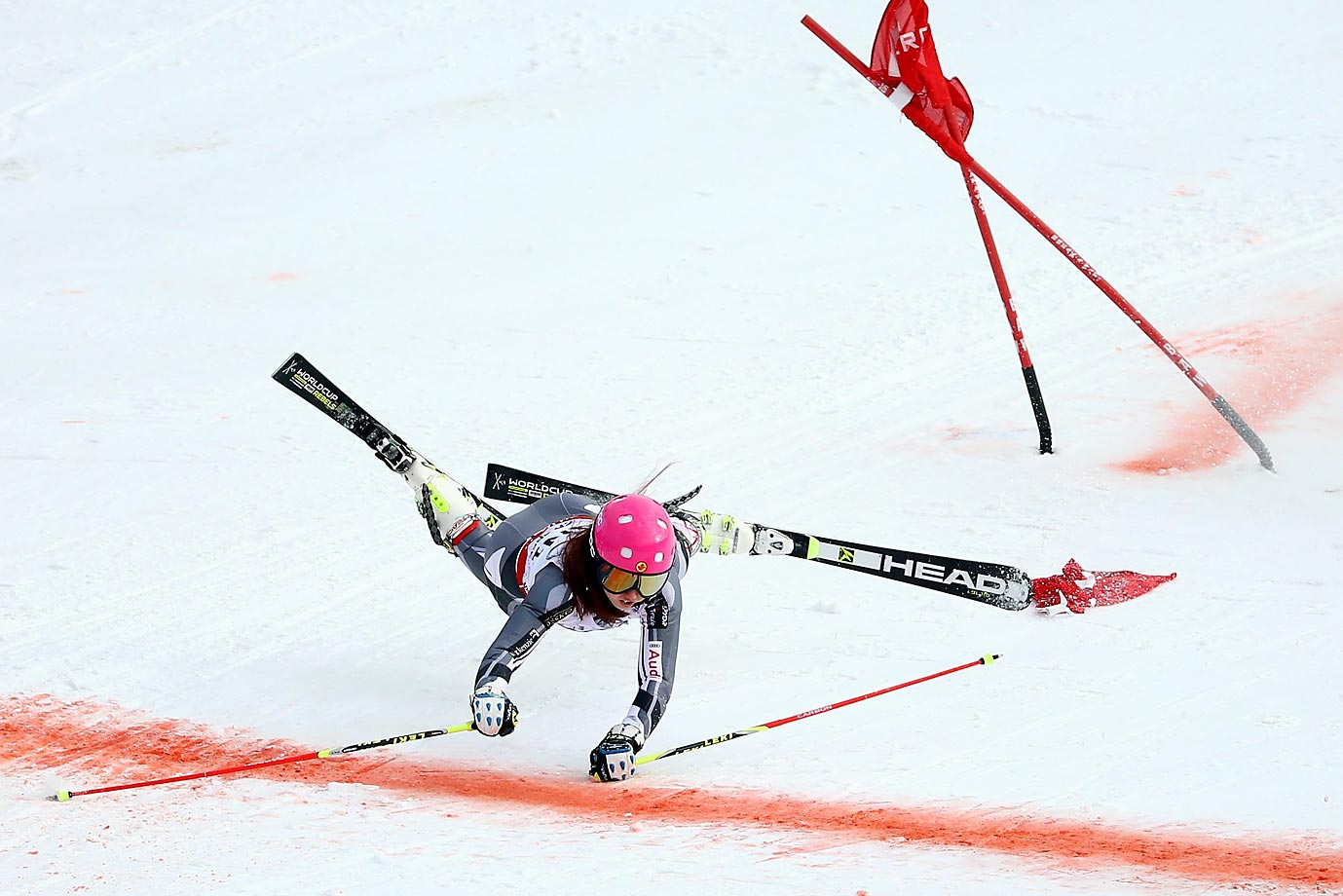 Candace Crawford crashes in her heat against Viktoria Rebensburg of Germany during the Nations Team Event of the 2015 FIS Alpine World Ski Championships.