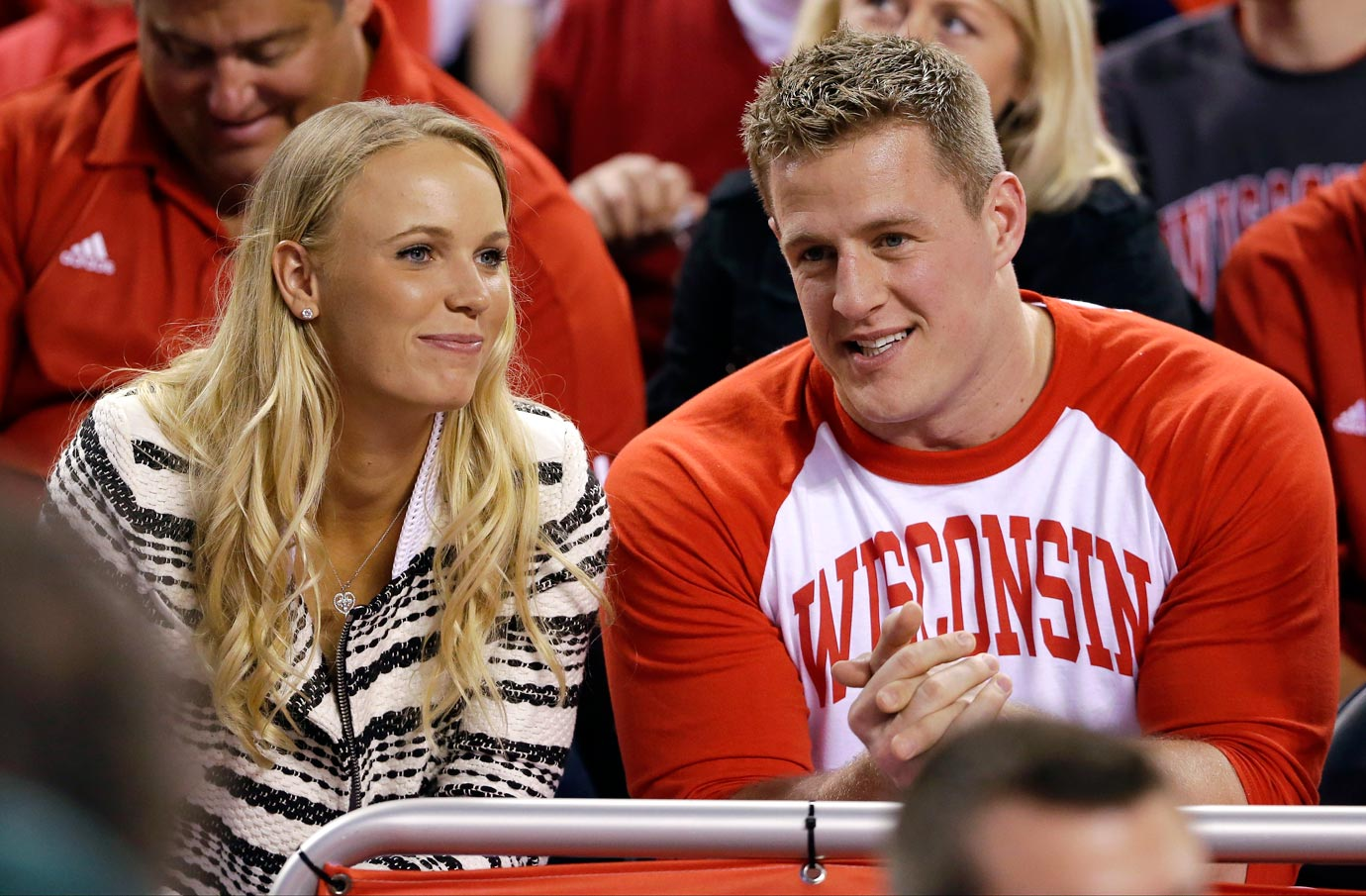 Tennis star Caroline Wozniacki and NFL defensive end J.J. Watt were seen together at the NCAA men's basketball national championship game between Wisconsin and Duke on April 6, 2015 in Indianapolis, leading to much speculation as to whether or not the two were a couple. After the two were spotted enjoying a private weekend in Fisher Island, Fla., and Watt was seen in Paris supporting Woz at the French Open, the speculation was over.