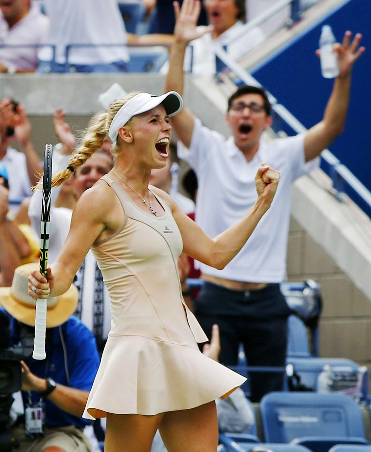 Caroline Wozniacki celebrates after winning a point against Maria Sharapova during the fourth round on Aug. 31.  Wozniacki, seeded 10th, defeated the fifth-seeded Sharapova, 6-4, 2-6, 6-2.