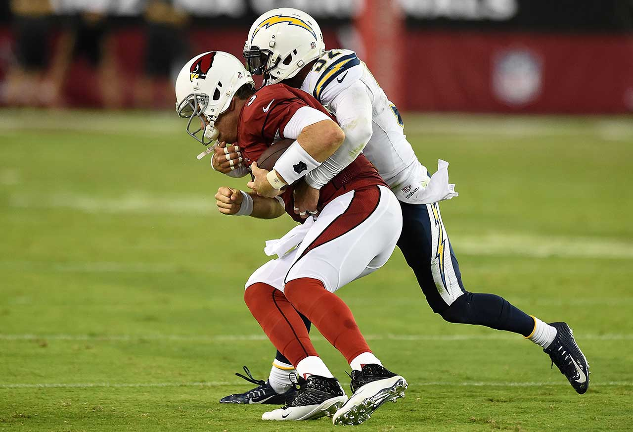 Palmer suffered nerve damage in his right throwing shoulder, presumably on this Week 1 tackle by San Diego's Eric Weddle, which forced him to miss the next three games of the 2014 season.