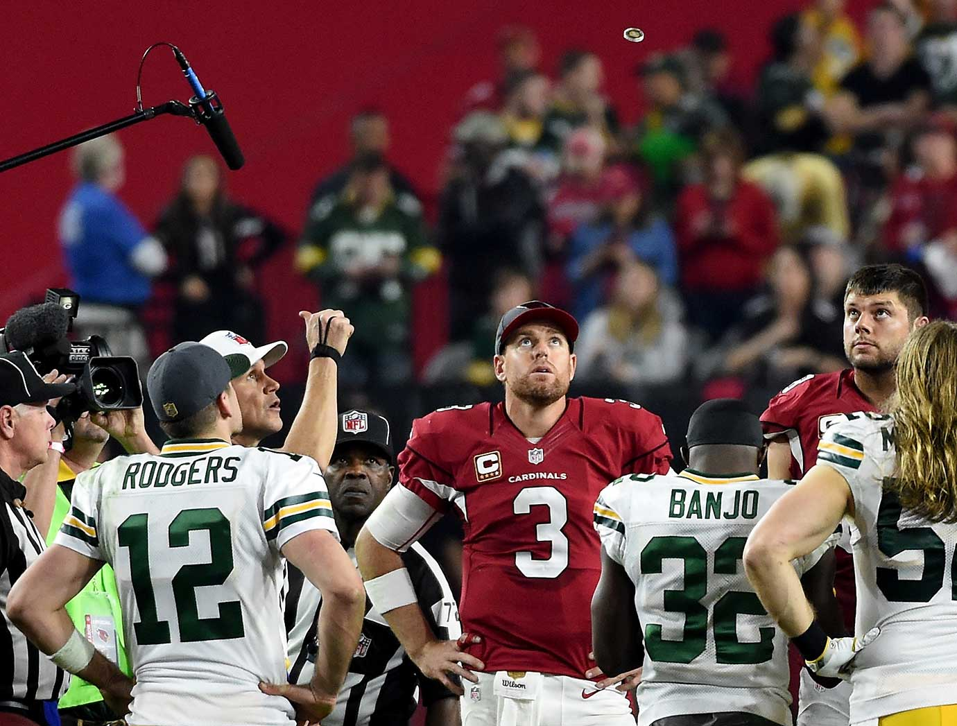 Carson Palmer and Aaron Rodgers watch the overtime coin toss in an NFC divisional playoff game. The Cardinals won the re-toss (the coin didn't flip the first time) and went on to score a touchdown on their first drive to survive 26-20 to give Palmer his first career playoff victory.