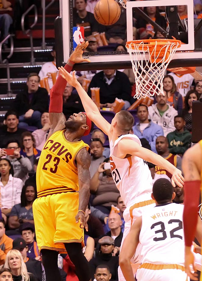 Lebron James makes a reverse layup in his first game back from injury for the Cleveland Cavaliers in their loss to the Phoenix Suns.