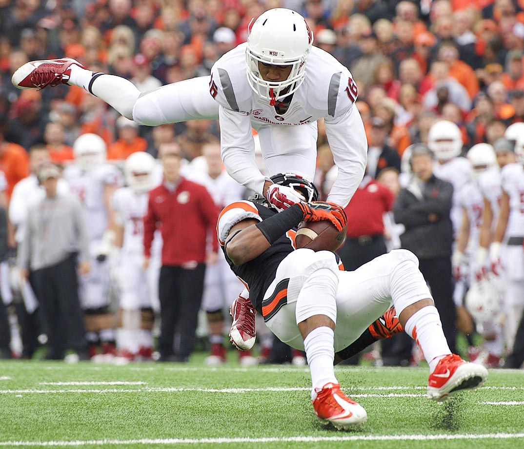 Washington State defender Charleston White tackles Oregon State receiver Jordan Villain. Washington State won 39-32.