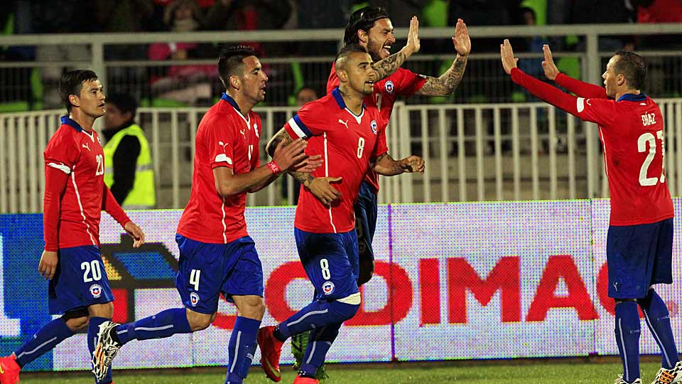 Chile's Charles Aranguiz, left, Mauricio Isla, second left, Arturo Vidal, center, Mauricio Pinilla, second right, and Marcelo Diaz celebrate after scoring against Northern Ireland, at a friendly soccer match in Valparaiso, Chile