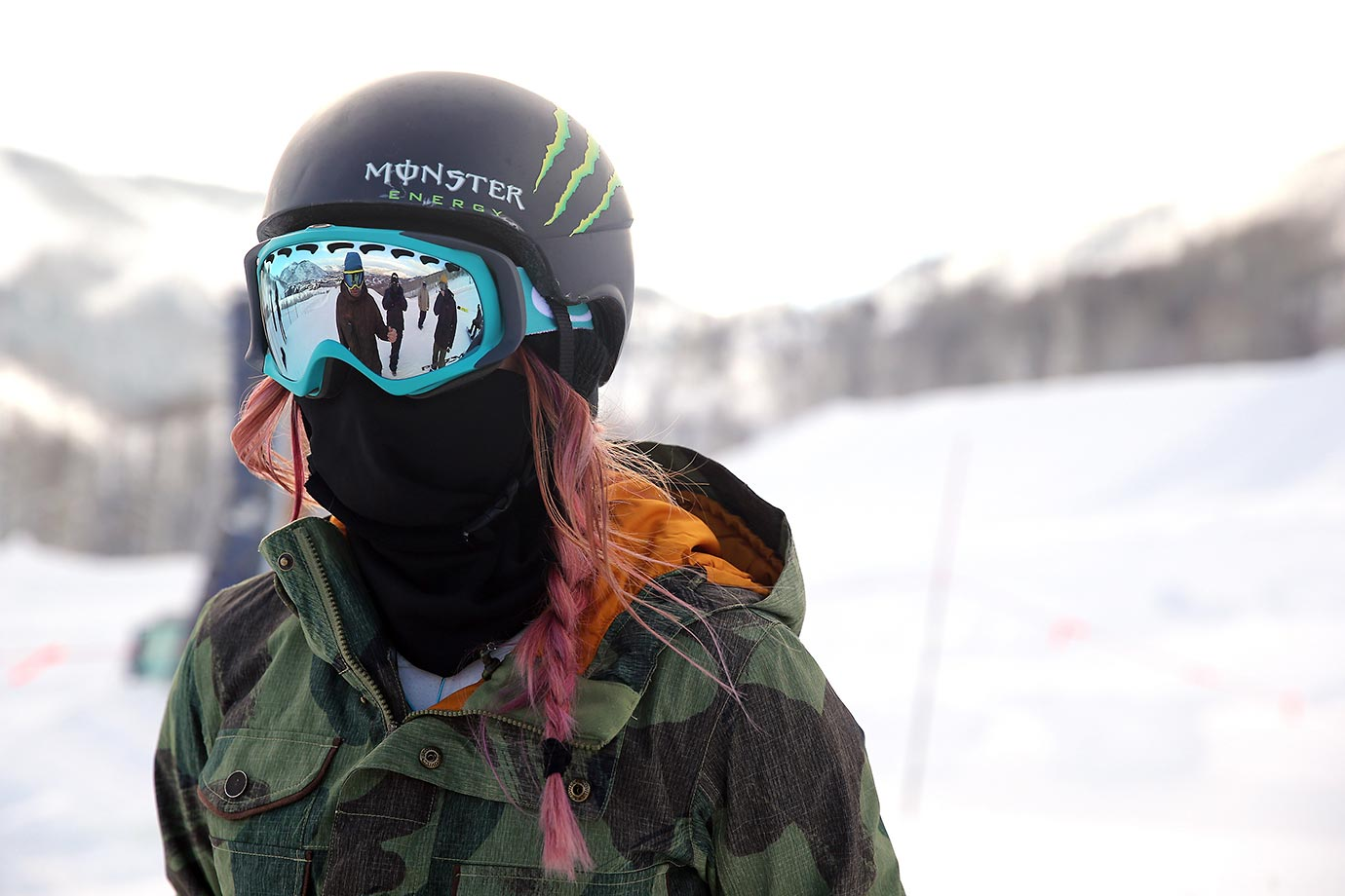 Chloe Kim listens to her US Olympic coaches during practice at Park City.