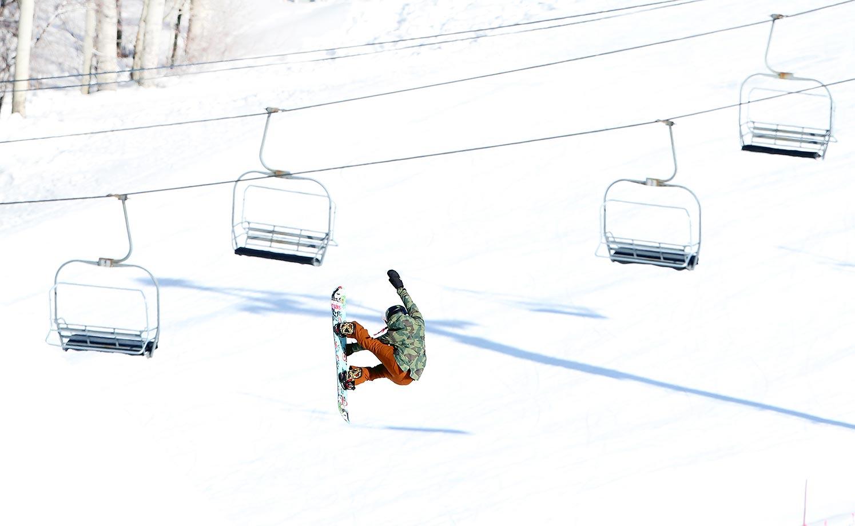 Chloe Kim gets airborne during snowboarding practice.