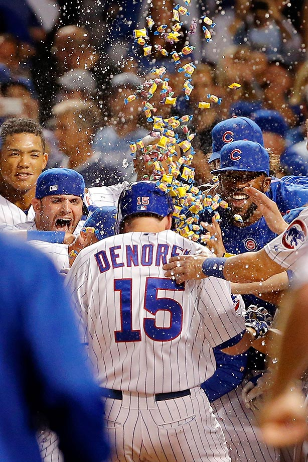 The Chicago Cubs celebrate Chris Denorfia's walk-off home run against the Kansas City Royals.