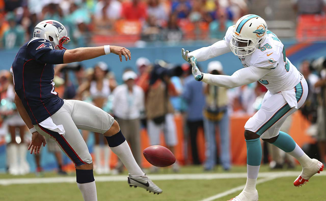 Ryan Allen of the New England Patriots has his first-quarter punt blocked by Chris McCain of the Miami Dolphins.