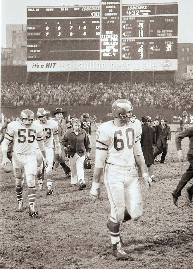 Bednarik walking off the field after the New York Giants.