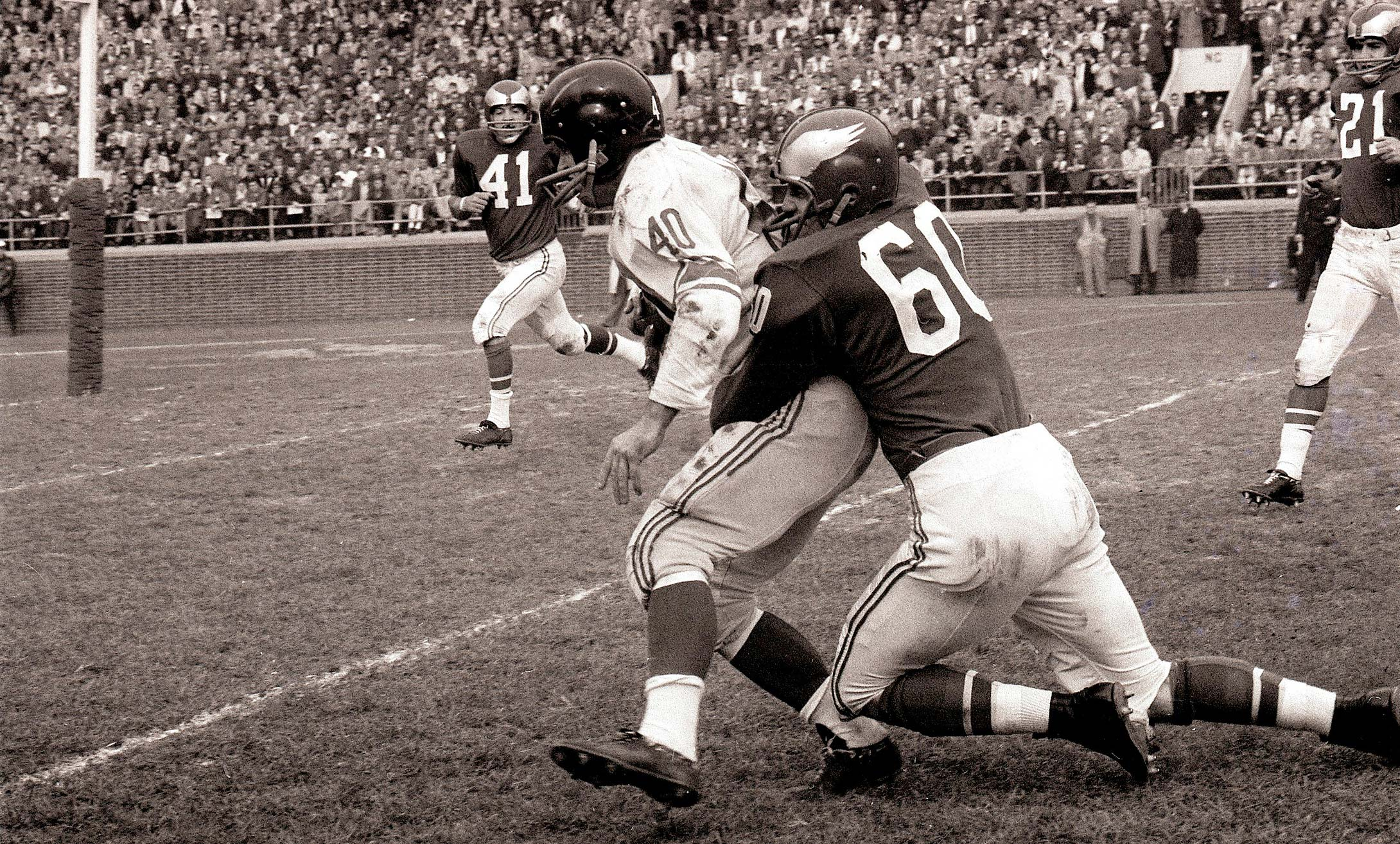 Chuck Bednarik tackles Joe Morrison.