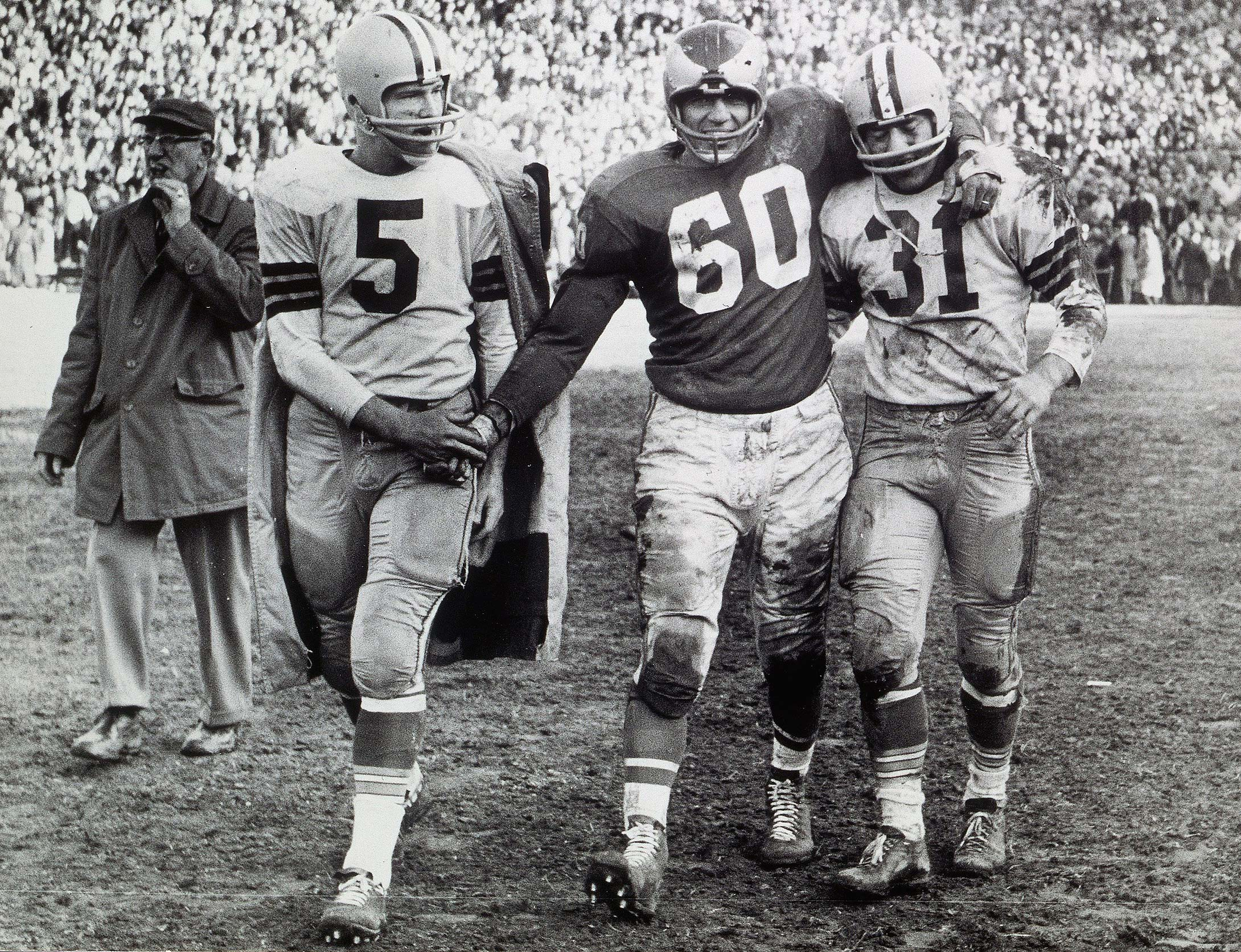 Chuck Bednarik with Green Bay's Paul Hornung (5) and Jim Taylor (31) after the 1960 championship game.