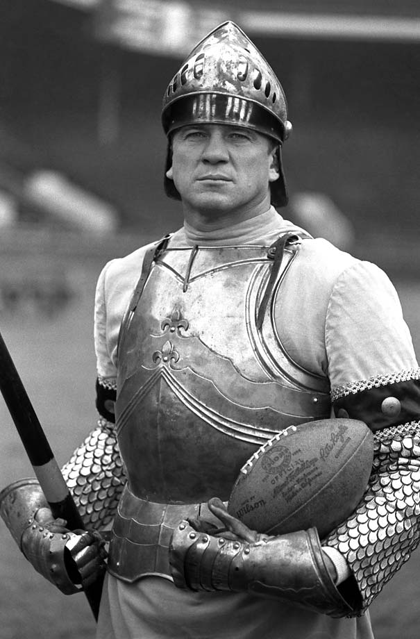 Chuck Bednarik poses in a medieval knight's armor, lance and helmet in 1960 at Franklin Field in Philadelphia.