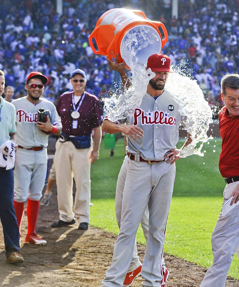 Cole Hamels of the Philadelphia Phillies gets the cooler after pitching a no-hitter against the Chicago Cubs.