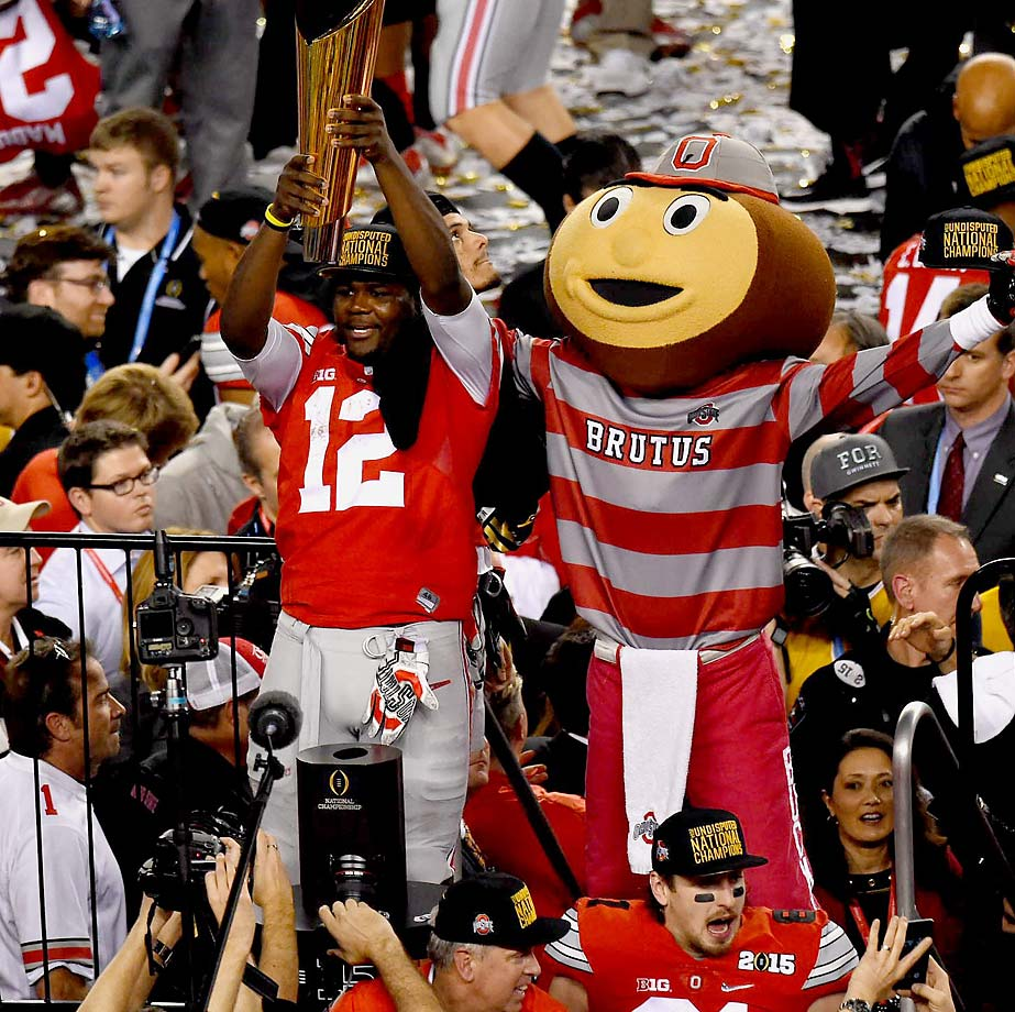 Ohio State quarterback Cardale Jones celebrates with the Buckeyes' mascot after his team's 42-20 win over Oregon in the National Championship game at AT&T Stadium in Arlington, Texas, Jan. 12, 2015.