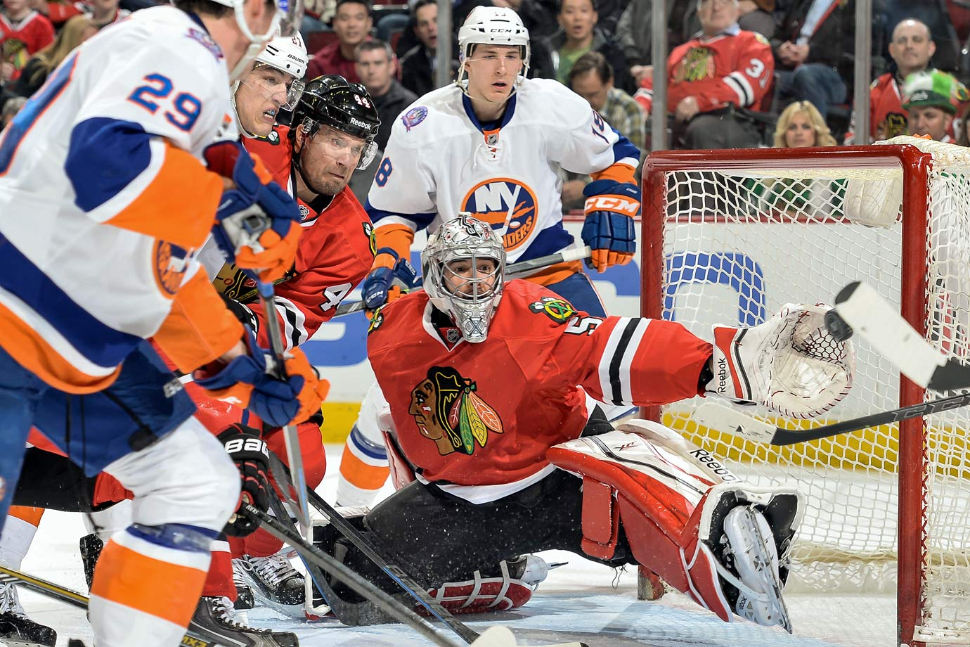 """Despite backstopping a Stanley Cup winner, Crawford has been regarded by many as the weak link in Chicago's armor, a beneficiary of reflected glory. That's just not the case. Consider his play this season, wherein the absence of Patrick Kane has stalled the offense and put more pressure on the Hawks' defense. Crawford responded with numbers that could top his career bests, including a .925 save percentage and 30 wins. """"As the games get bigger,"""" said coach Joel Quenneville, """"he gets bigger."""""""