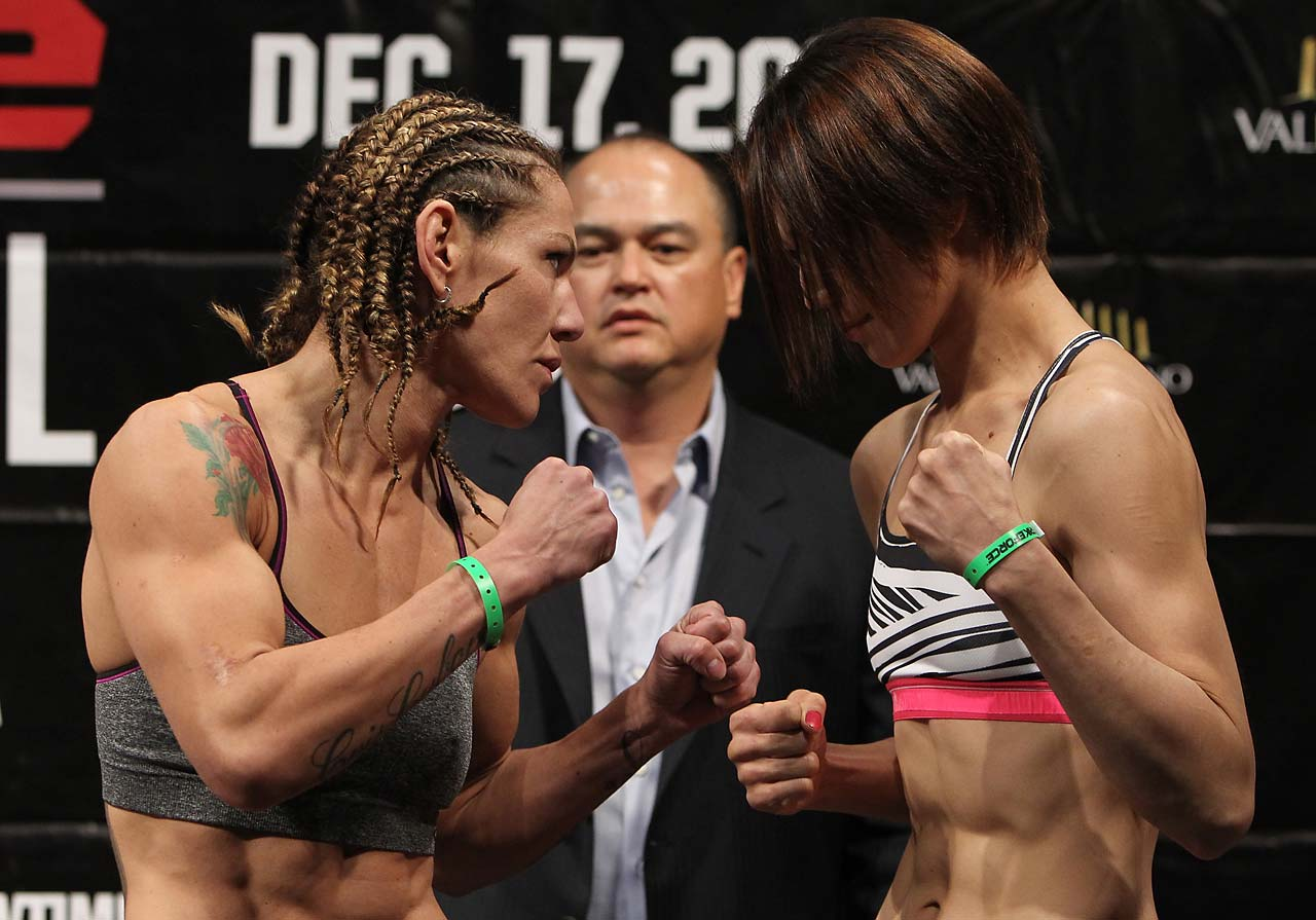 Justino and challenger Hiroko Yamanaka face off after weighing in for their December 2011 bout. The 16-second victory by Justino was changed to a no decision after she tested positive for steroids.