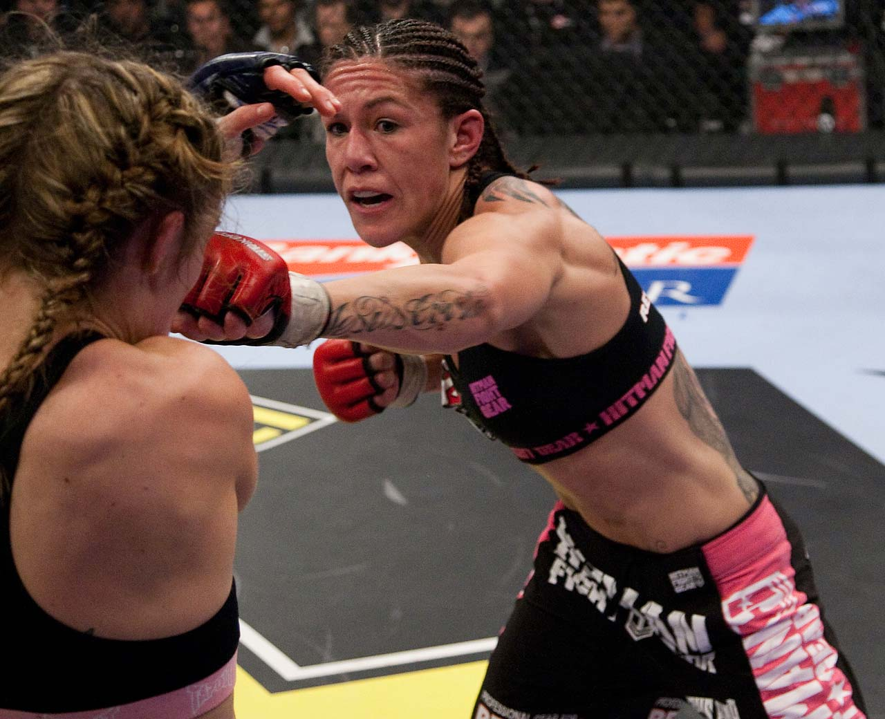 Justino punches Marloes Coenen during their featherweight championship bout in January 2010.