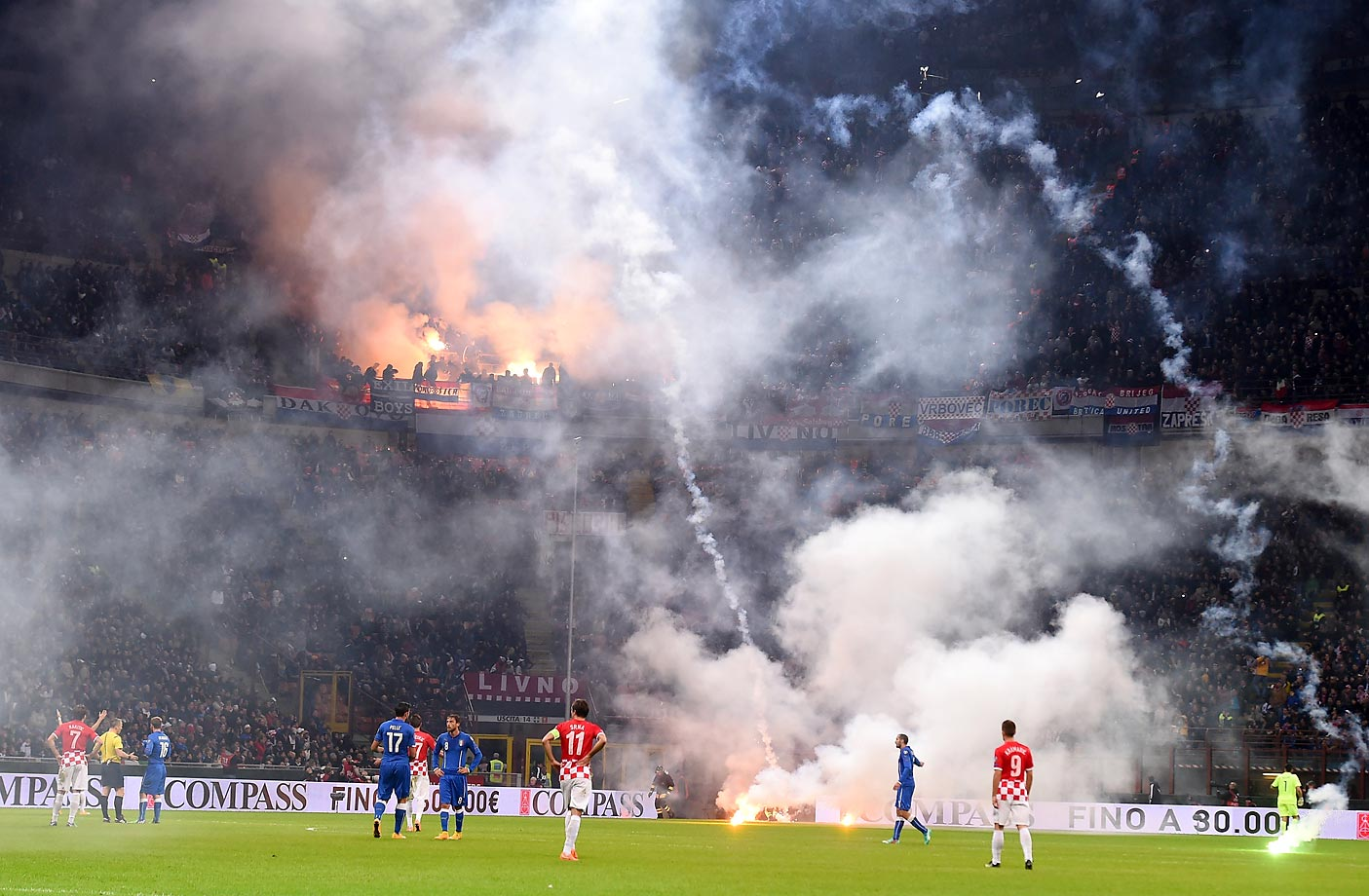 Fans of Croatia throw flares onto the field during the EURO 2016 Group H Qualifier match between Italy and Croatia.