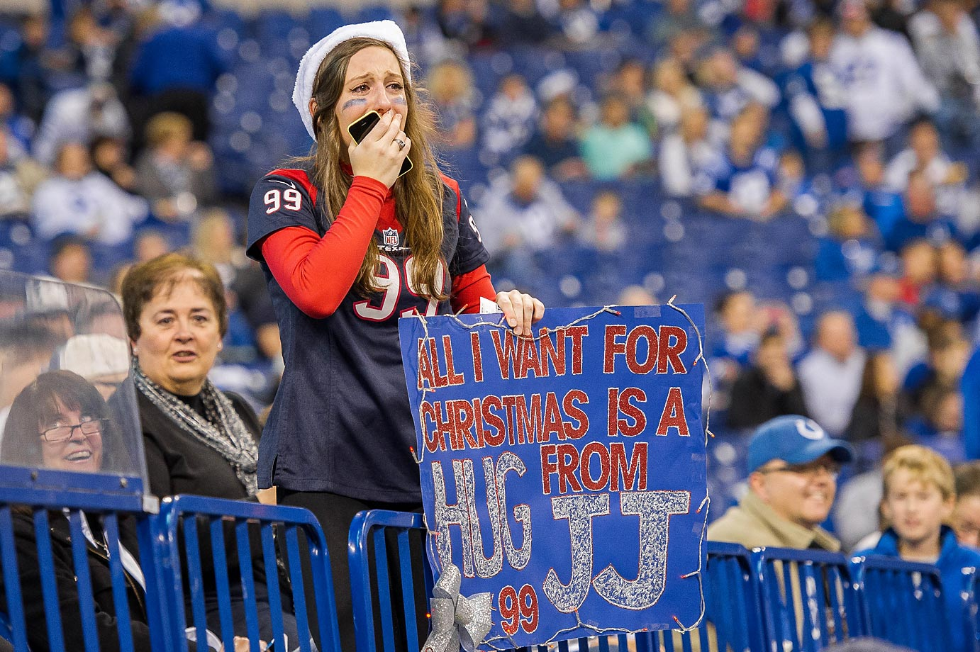 A Texans fan reacts after J.J. Watt granted her Christmas wish and gave her a hug before the game against the Indianapolis Colts.