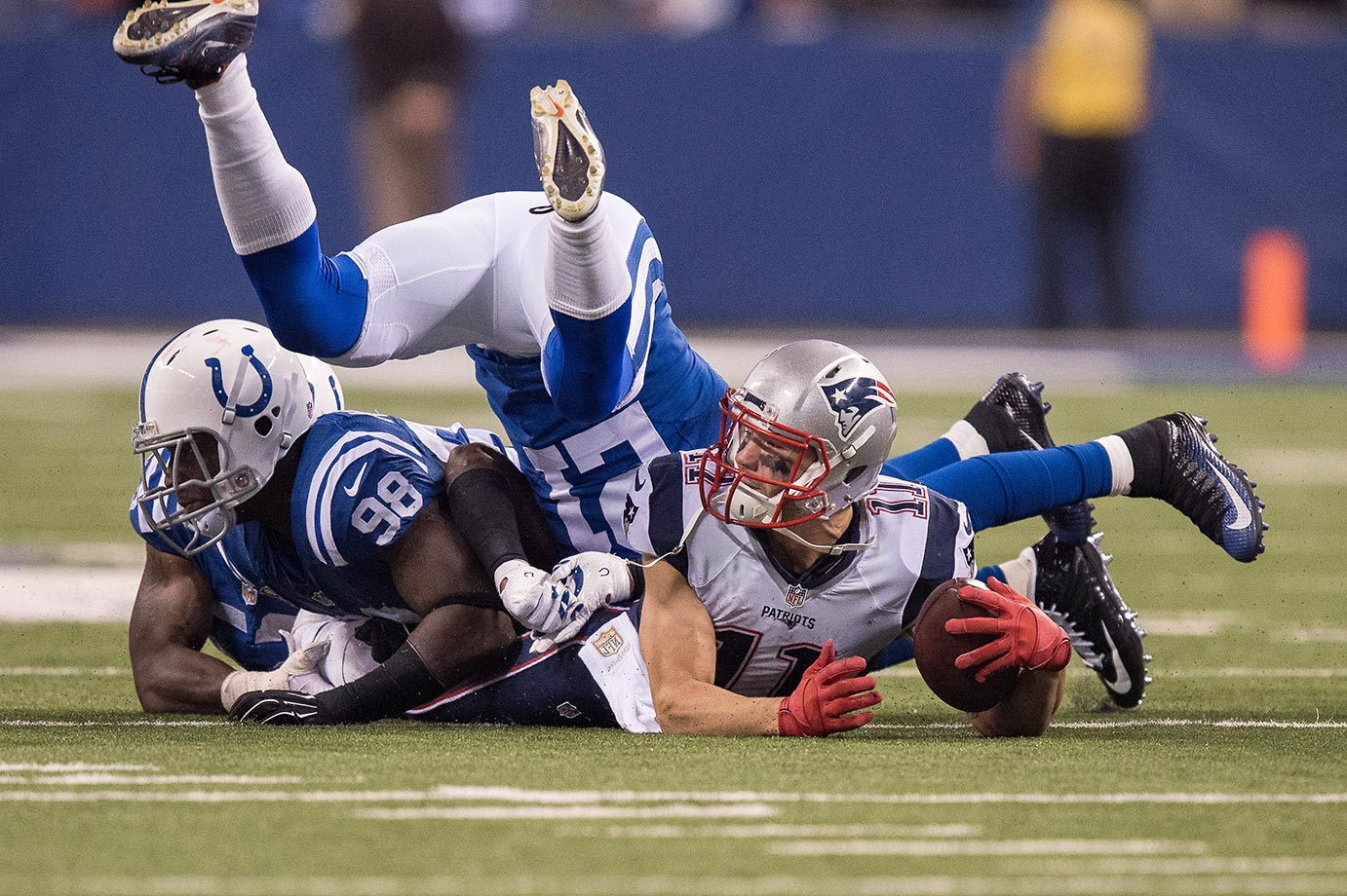 Vontae Davis and Robert Mathis of the Indianapolis Colts can't stop Julian Edelman of the Patriots from making a first down.