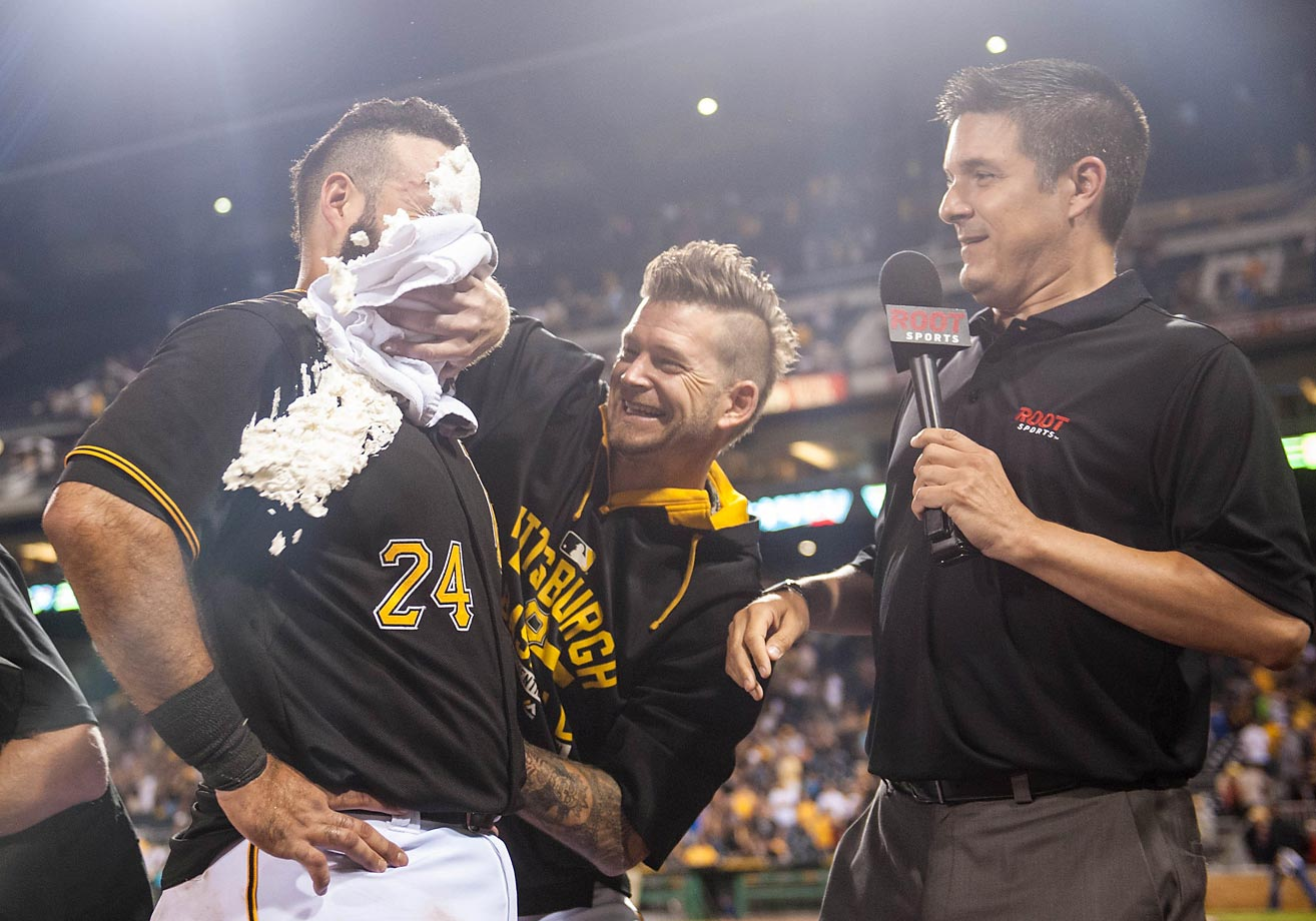 Pedro Alvarez of the Pittsburgh Pirates gets a whipped cream pie in the face from A.J. Burnett after hitting a walk-off single to give the Pirates a 2-1 win over the Padres.