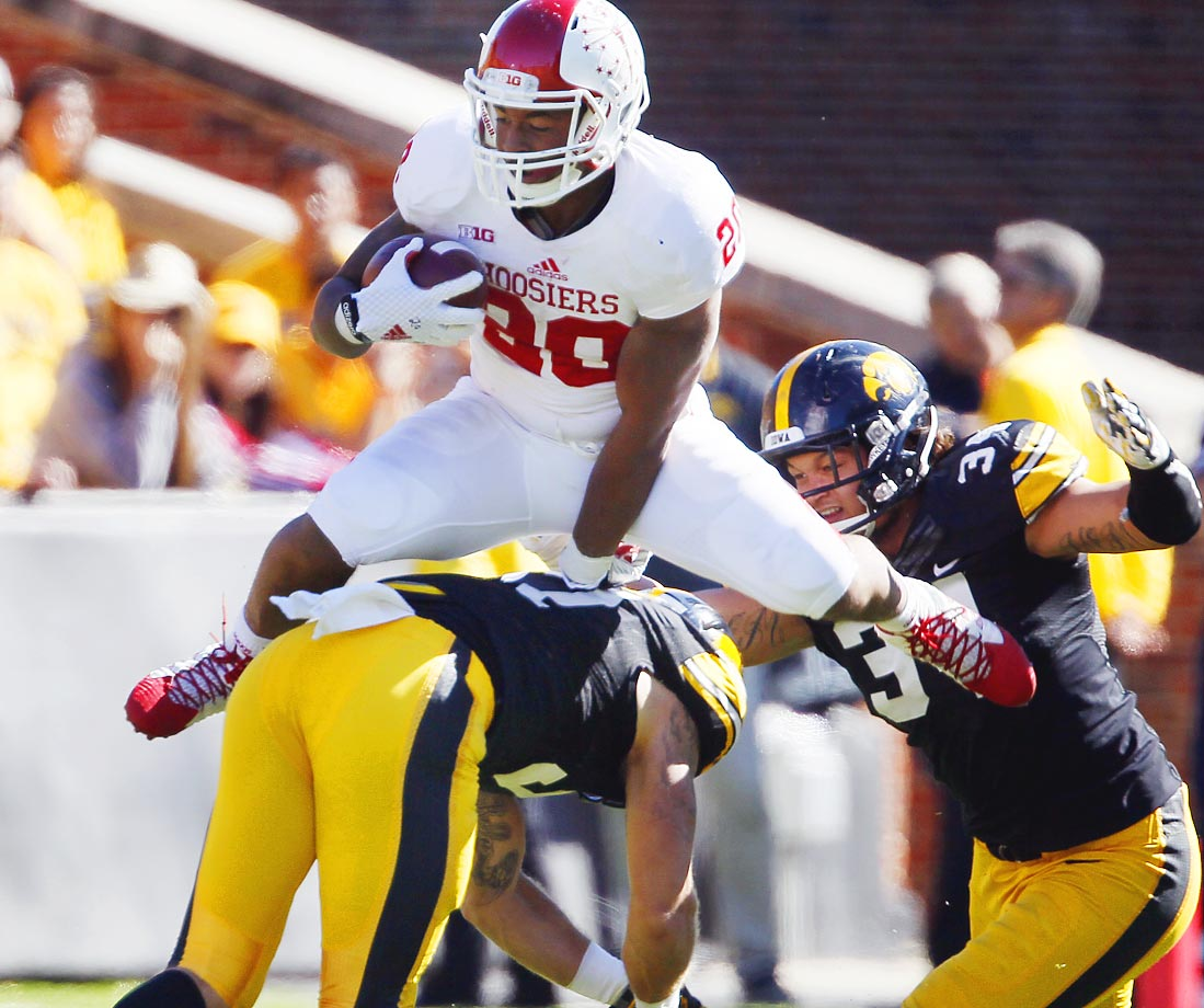 Indiana running back D'Angelo Roberts hurdles Iowa defensive back John Lowdermilk. The Hawkeyes beat the Hoosiers 45-29.