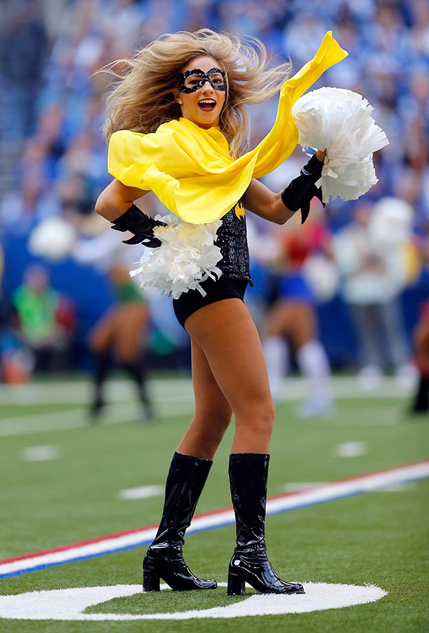 An Indianapolis Colts cheerleader in costume at a Saints game a week before Halloween.