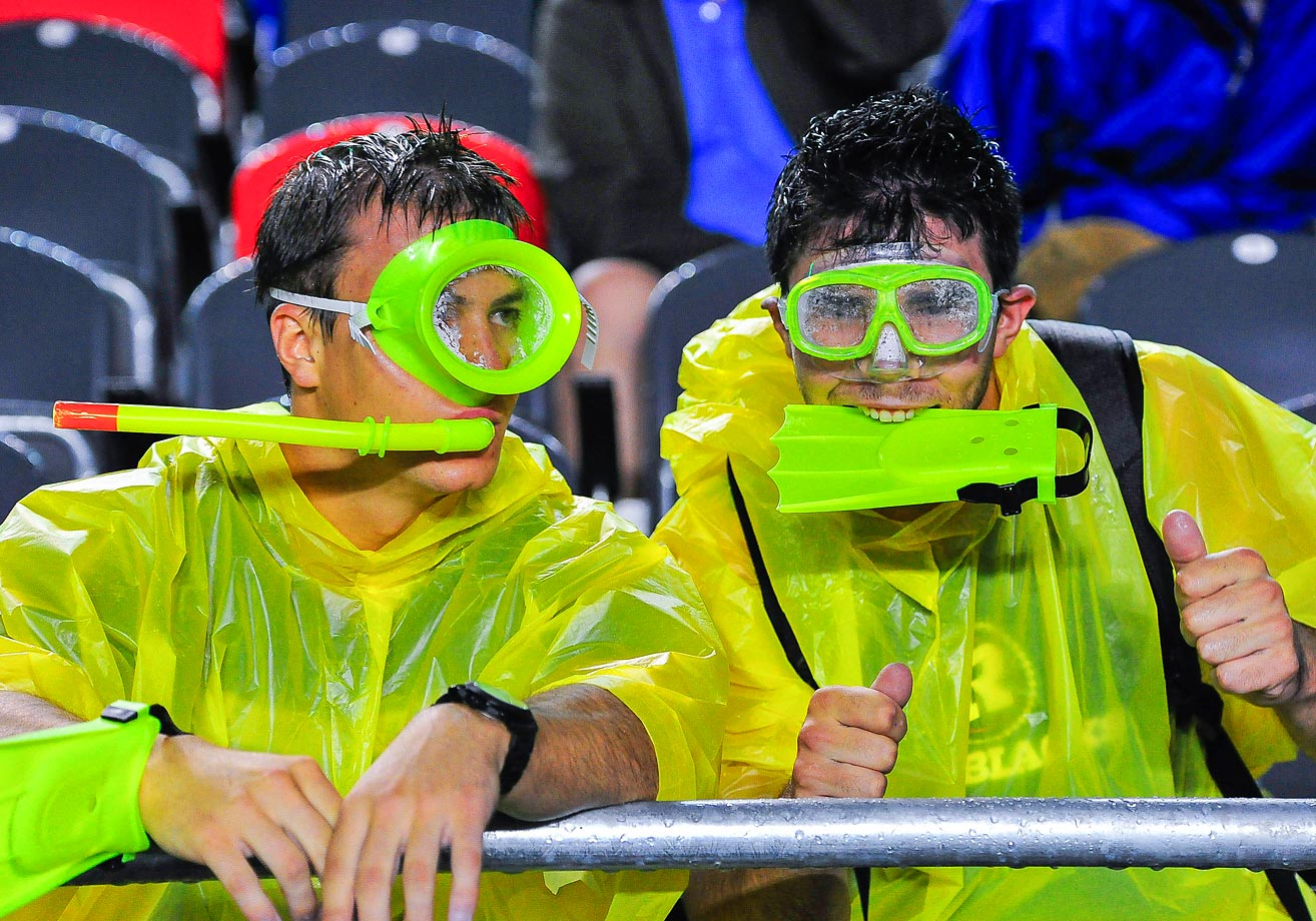 A couple of Ottawa RedBlacks fans came prepared for the heavy rain during their game against the BC Lions.