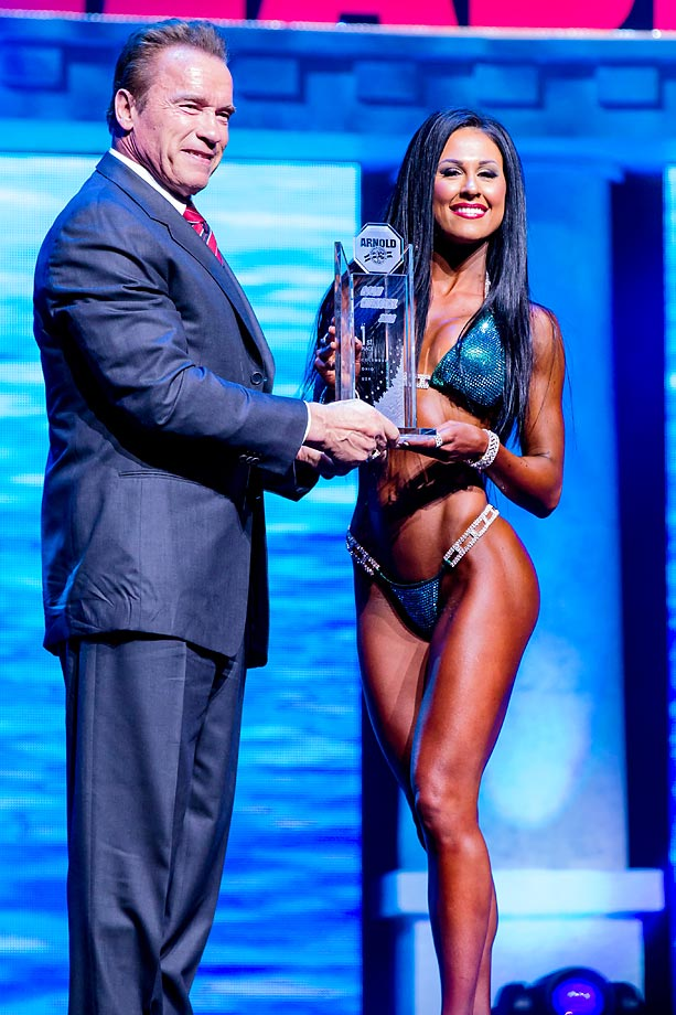 Arnold Schwarzenegger with Ashley Kaltwasser after she was crowned champion in Bikini International as part of the Arnold Sports Festival in Columbus, Ohio.  Kaltwasser won the Bikini International for the second year in a row.
