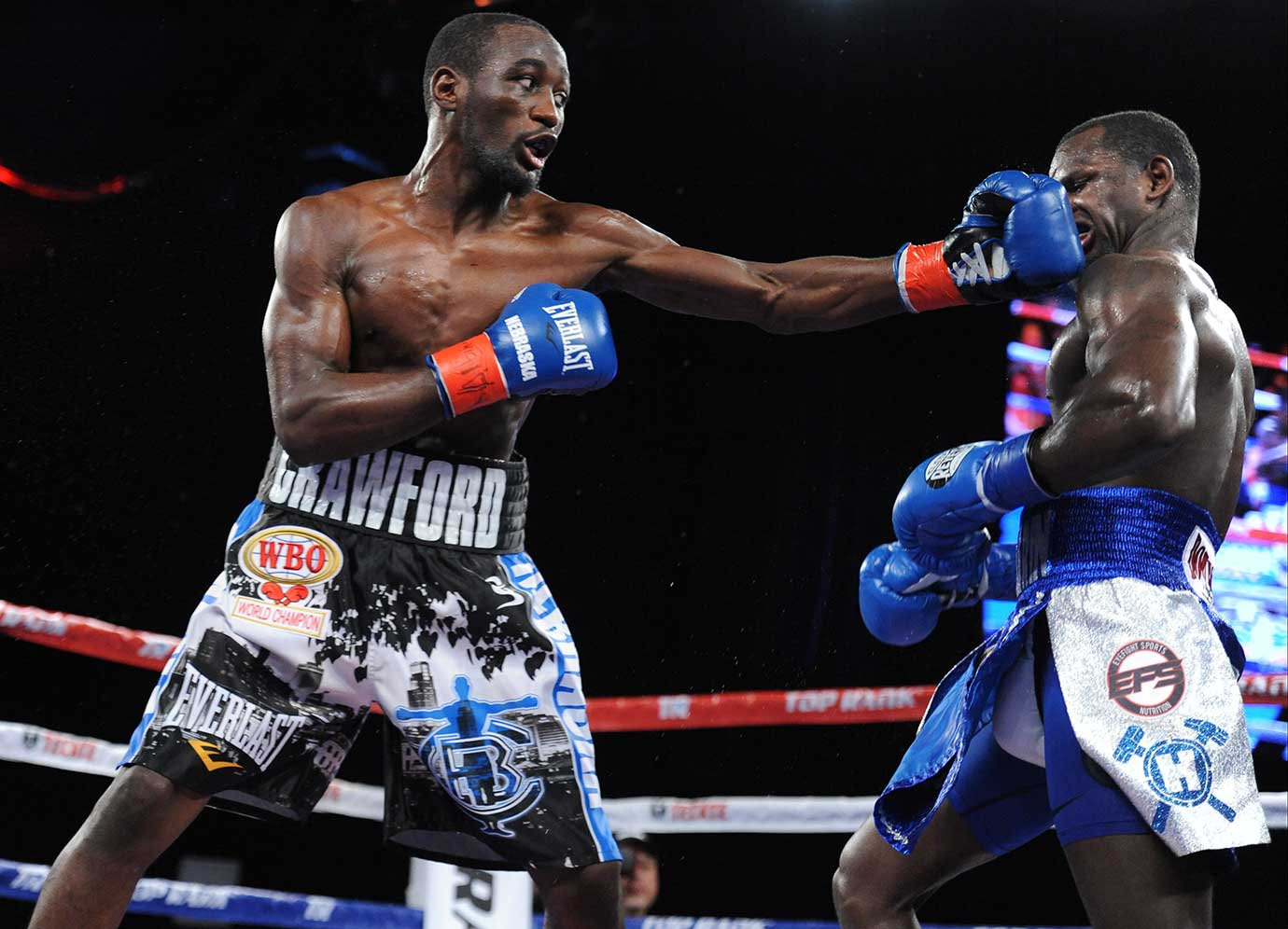 Terrance Crawford lands a hook on Henry Lundy in their lightweight title bout at MSG.