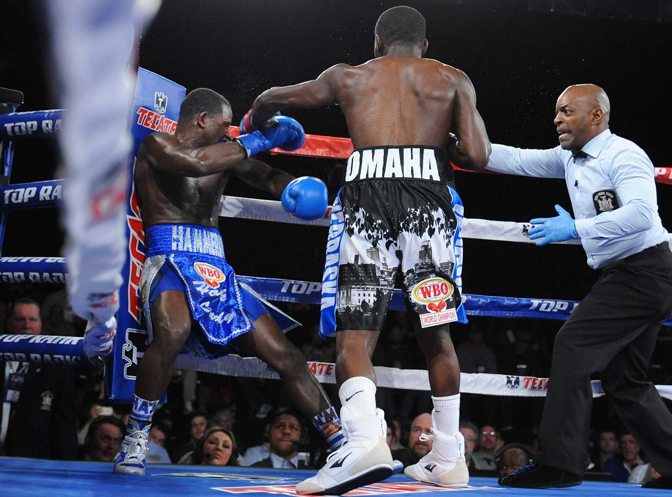 Terrance Crawford drills Henry Lundy as the ring official moves in to stop the action.