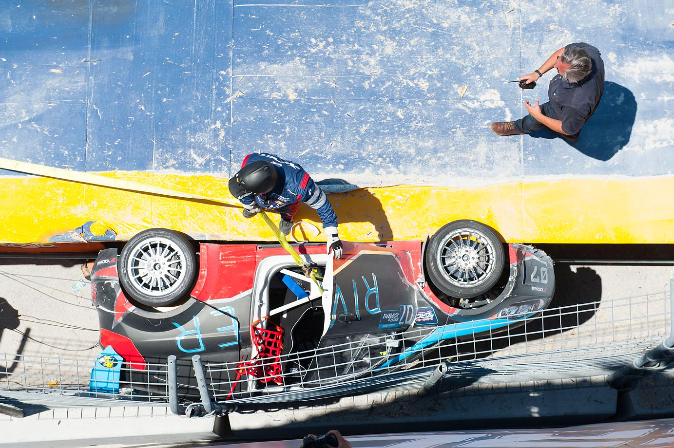 Collete Davis crashes off the ramp and the car gets stuck between the ramp and side wall at the Red Bull Global Rallycross.