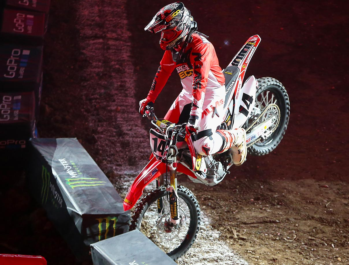 Honda rider Kevin Windham rams a wall during the AMSOIL Arenacross at the Smoothie King Center in New Orleans.