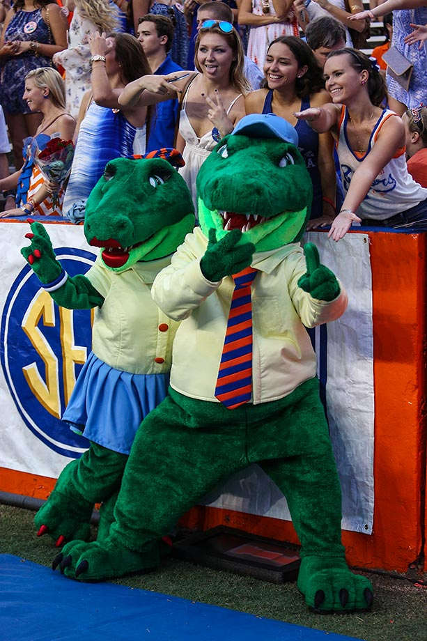 Florida Gators mascots Alberta (left) and Albert (right) pose with fans during to the game between the Florida Gators and the New Mexico State Aggies.
