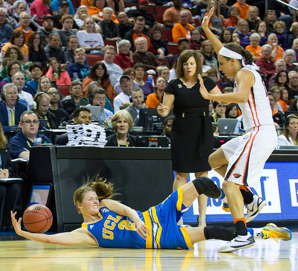 UCLA guard Kari Korver dives for a loose ball on a night in which Oregon State won its first PAC-12 Women's Tournament.
