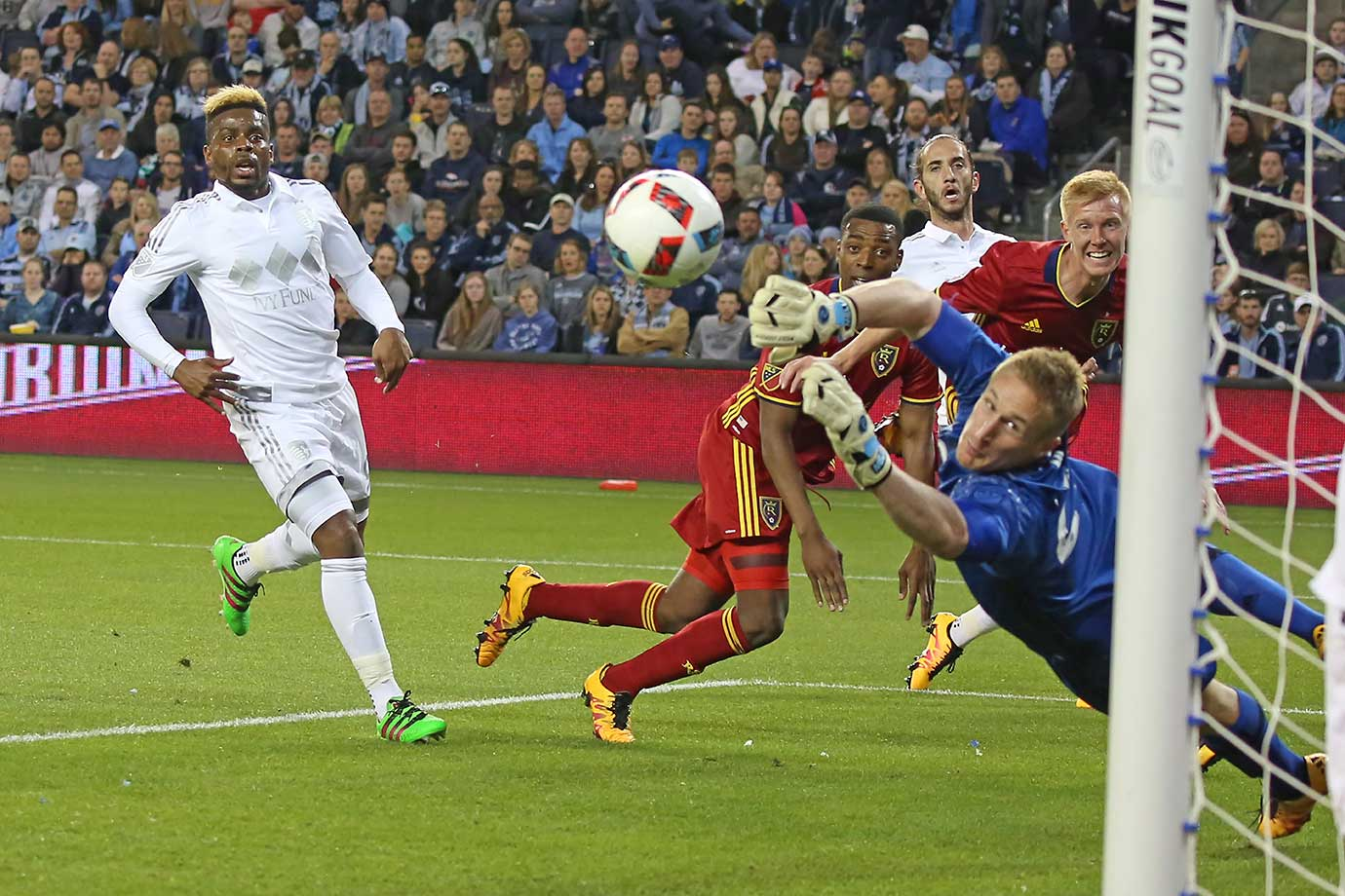 Sporting Kansas City goalkeeper Tim Melia can't stop the header from Real Salt Lake defender Justen Glad for a goal.