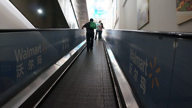 The people mover that leads to the Wuhan Wal-Mart.
