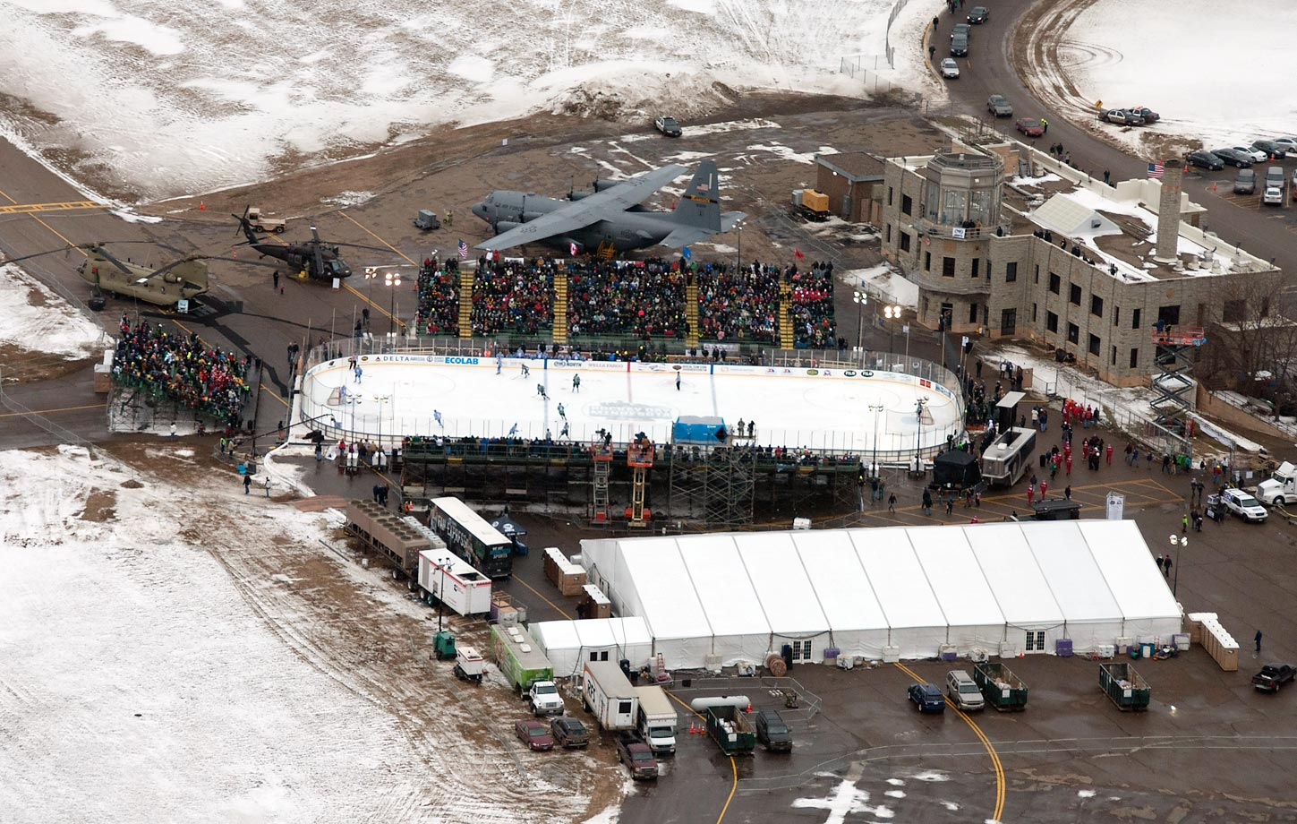 As part of Hockey Day Minnesota, an outdoor ice rink was built on an active airport tarmac for the first time. High school students played on the rink while a military unit from the airport on active duty in Kuwait watched from overseas. The event took place in St. Paul, Minn.
