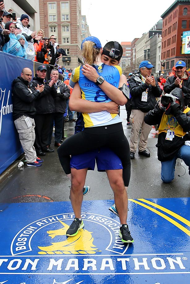 Mayoral Chief of Staff Daniel Koh and runner Amy Sennett celebrate after getting engaged at the Finish line.