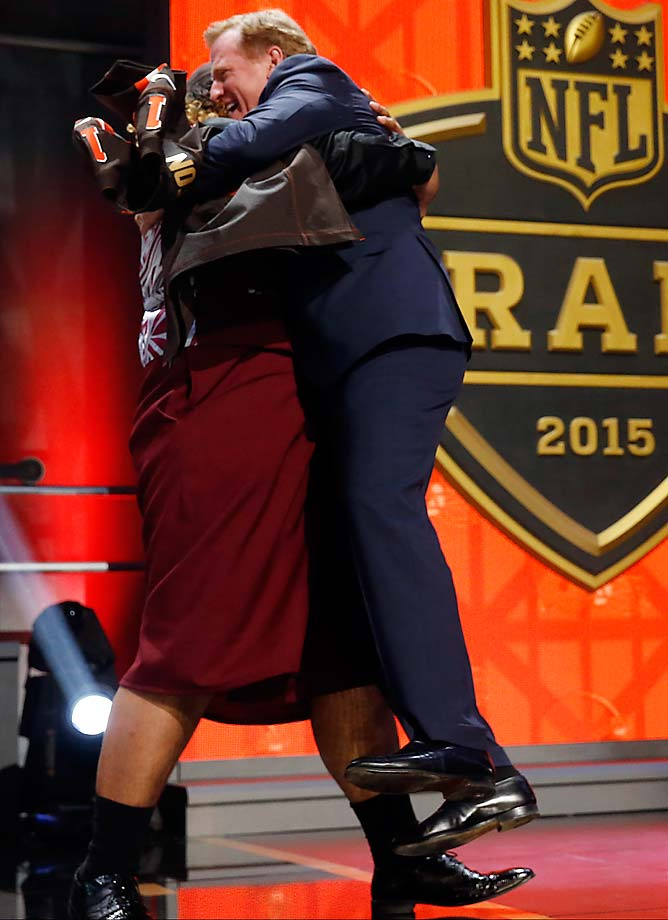 Washington defensive lineman Danny Shelton picks up NFL commissioner Roger Goodell as he celebrates after being selected by the Cleveland Browns as the 12th pick.