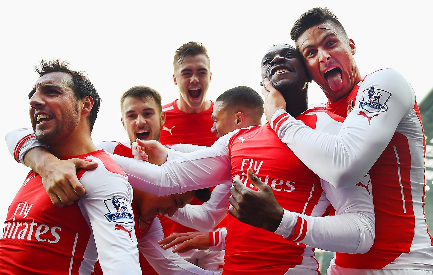 Danny Welbeck of Arsenal (2R) celebrates with team mates Olivier Giroud, Santi Cazorla, Calum Chambers and Aaron Ramsey of Arsenal as he scores their first goal during the Barclays Premier League match between West Bromwich Albion and Arsenal