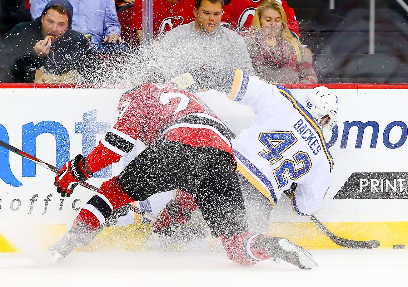 St. Louis Blues center David Backes and New Jersey Devils defenseman Eric Gelinas go after the puck during the third period. The Blues defeated the Devils 1-0.